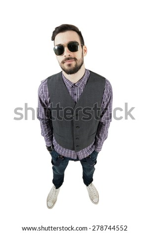 Confident young relaxed hipster with hands in pockets. High view wide angle lens portrait isolated over white background.  #278744552