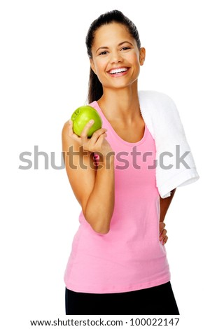 confident young sporty hispanic woman holds a fresh apple after a gym session promoting healthy eating and healthy lifestyle