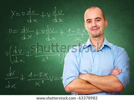 confident young teacher and classic chalkboard background
