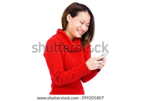Confident young woman using mobile phone on white background