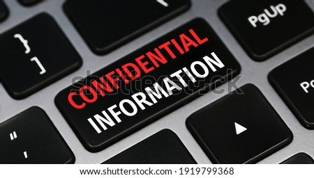 Confidential information text on a keyboard. Technology and business concept. Сток-фото ©