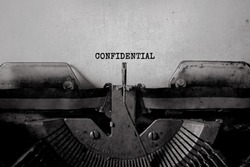 confidential - typed words on a Vintage Typewriter