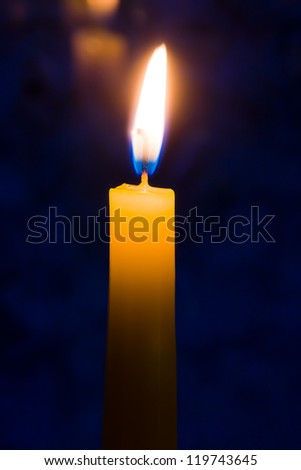 conflagrant candle dark blue background