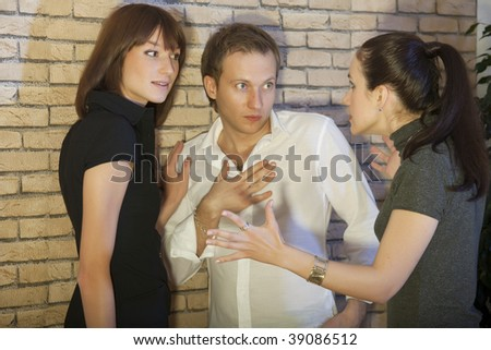 conflict between friends - angry woman speaks to the couple - stock photo