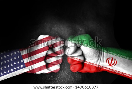 Conflict between USA and Iran, male fists with flags painted on skin isolated on black background - governments conflict concept