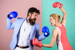 Conflict concept. Family quarrel. Boxers fighting in gloves. Domination concept. Gender battle. Gender equal rights. Gender equality. Man and woman boxing fight. Couple in love competing in boxing.