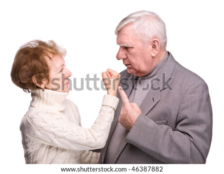 Conflict elderly couple on a white background