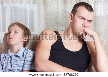 Conflict  of father and son, indoor - stock photo