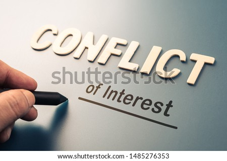 Conflict of Interest, hand writing text attach the letters word to complete concept Foto stock ©