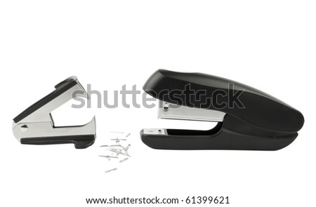Conflict of interests - office supplies - a stapler and a staple remover facing each other with several used staples lying between them.