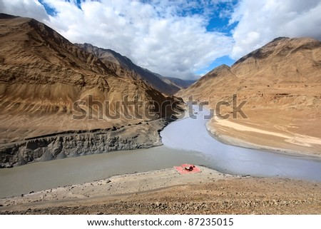 Confluence of rivers Zanskar and Indus in Himalayan mountains, Ladakh, Jammu and Kashmir. India - stock photo