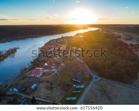 Confluence of two rivers (Namunas and Neris) Kaunas city, Lithuania. Sunset aerial view image.  #617156420