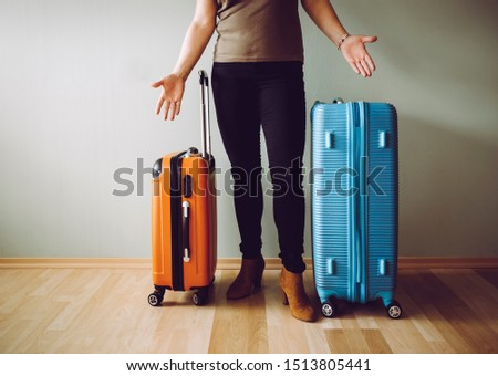 Confused air passenger standing with luggage, stranded in airport. Traveling agency bankruptcy concept.