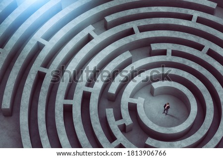 Confused businessman thinks how to find the right way to exit from a big maze