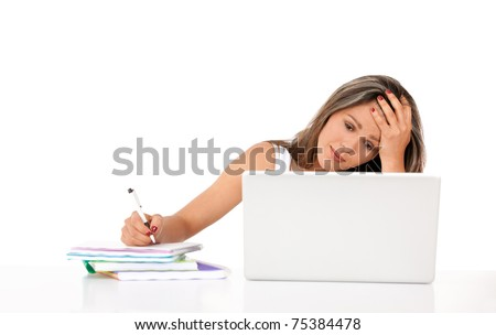 Confused female student with a laptop and notebooks ? isolated