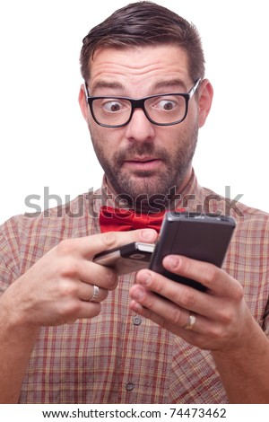 Confused geek using two gadgets at a time. Isolated on white.
