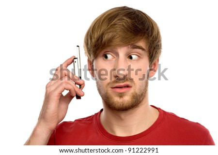 Confused man with mobile phone