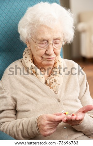 Confused Senior Woman Looking At Medication