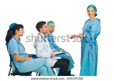 Confused surgeon woman dont know what to do at seminar and her colleagues being surprised about her attitude