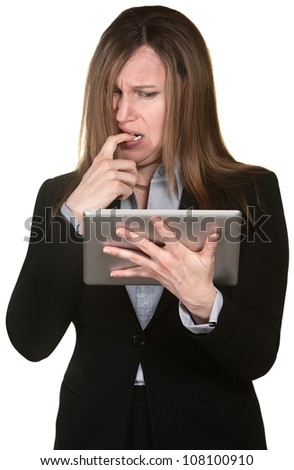 Confused woman holding tablet over white background - stock photo