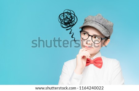 Confused young asian kid. Foto stock ©