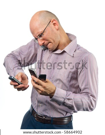 Confused young man with many phones