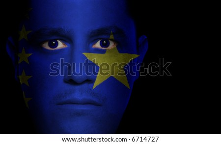 Congolese flag painted/projected onto a man's face