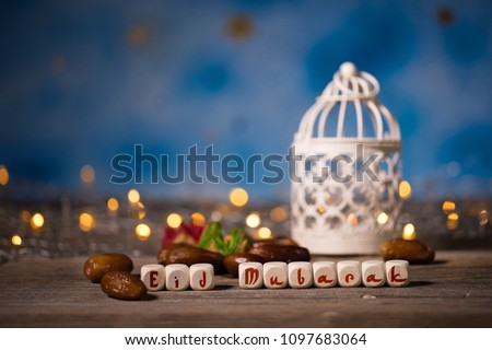 Congratulation EID MUBARAK composed of wooden dices. Closeup #1097683064