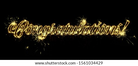 Congratulations banner with glitter decoration and fireworks. Text Congratulations written sparkling sparklers fireworks isolated on black background. Overlay template for greeting card.