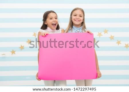 Congratulations concept. Amazing news. Girls hold congratulations banner. Kids holding banner for announcement. Children happy blank paper greetings copy space. Happy holidays. Congratulations to you. #1472297495