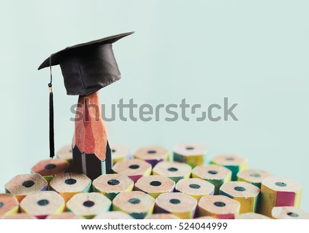 congratulations graduates background, inscription in pencil and graduate cap