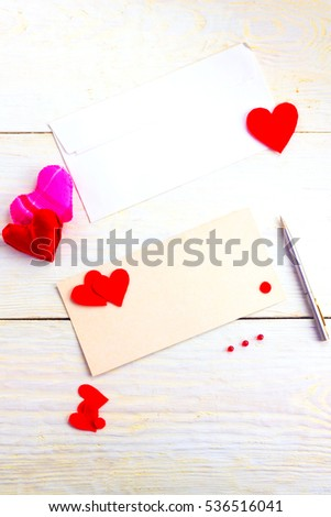 congratulations on Valentine's Day, blank cards with envelopes and empty valentine on a wooden table #536516041