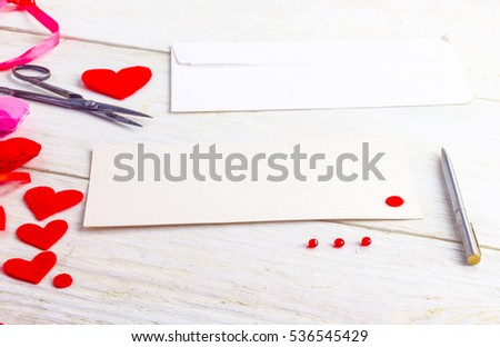 congratulations on Valentine's Day, blank cards with envelopes and empty valentine on a wooden table #536545429