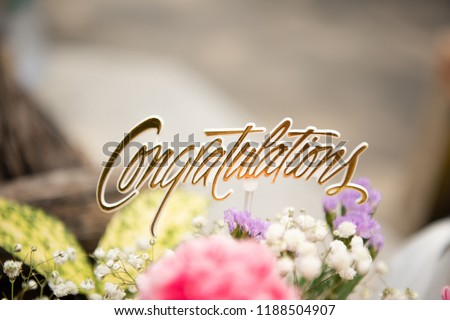 Congratulations sign on the wonderful color flower make for graduate degree closeup picture.   #1188504907
