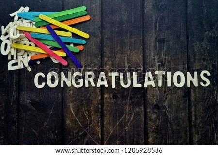 CONGRATULATIONS word by wood letters on wood background.  #1205928586
