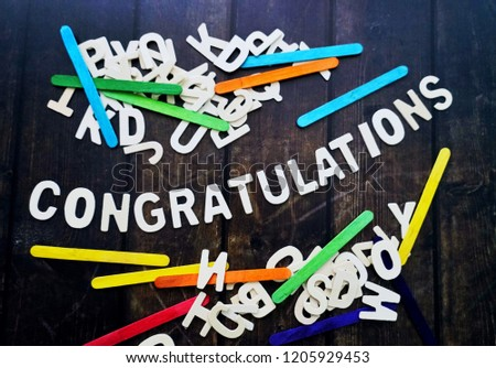 CONGRATULATIONS word by wood letters on wood background.  #1205929453