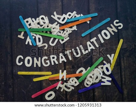CONGRATULATIONS word by wood letters on wood background.  #1205931313
