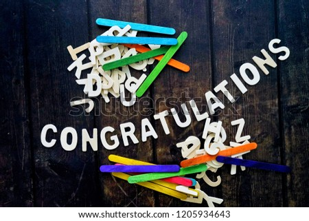 CONGRATULATIONS word by wood letters on wood background.  #1205934643