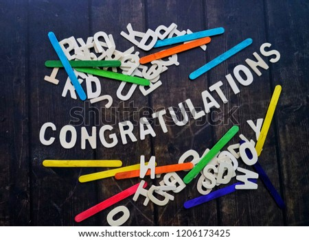 CONGRATULATIONS word by wood letters on wood background.  #1206173425