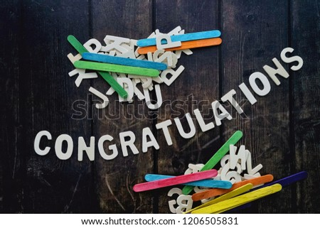 CONGRATULATIONS word by wood letters on wood background.  #1206505831