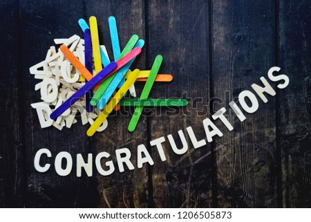 CONGRATULATIONS word by wood letters on wood background.  #1206505873