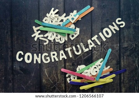 CONGRATULATIONS word by wood letters on wood background.  #1206566107
