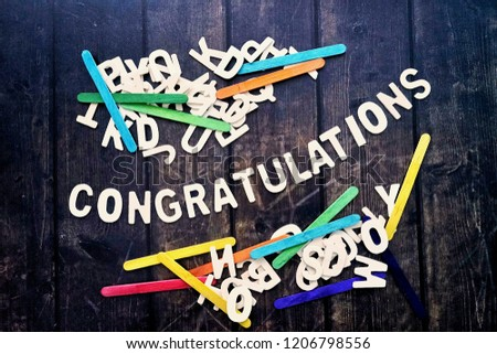 CONGRATULATIONS word by wood letters on wood background.  #1206798556