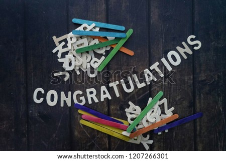 CONGRATULATIONS word by wood letters on wood background.  #1207266301