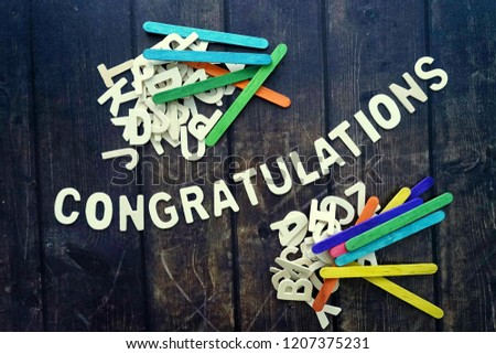 CONGRATULATIONS word by wood letters on wood background.  #1207375231