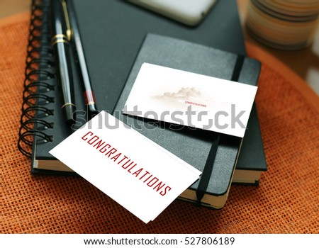 Congratulations words written on wooden table with diary and pen #527806189