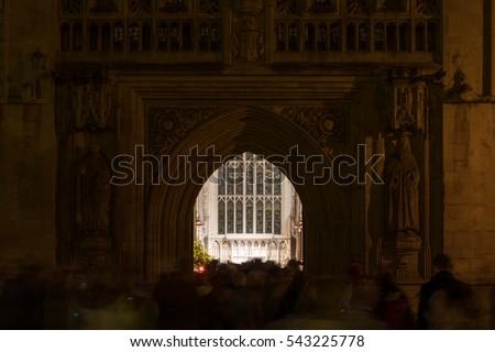 Congregants leaving Christmas Midnight Mass at Bath Abbey. Hundreds of people leave religious service celebrating & Free photos Bath Abbey Door England UK | Avopix.com
