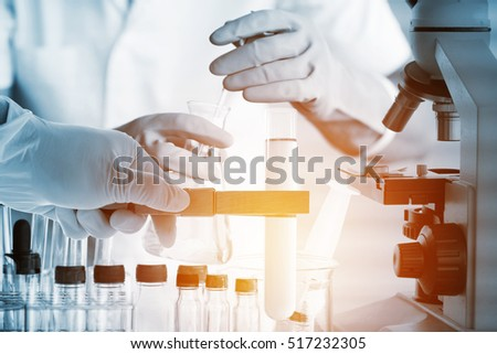 Conical flask in scientist hand with lab glassware background, Laboratory research concept #517232305