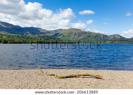 Coniston lake The Lakes National Park England uk on a beautiful sunny blue sky summer day popular tourist attraction with mountains in background