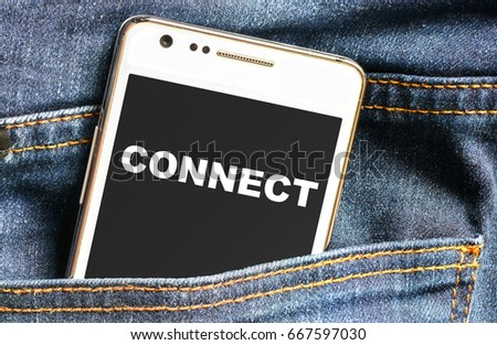 Connect inscription on phone screen / Smartphone in front jeans pocket with connect inscription #667597030
